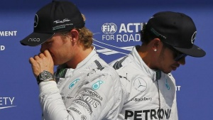 Mercedes Formula One driver Nico Rosberg (L) of Germany and team mate Lewis Hamilton of Britain walk next to each other after the qualifying session at the Belgian F1 Grand Prix in Spa-Francorchamps August 23, 2014.   REUTERS/Yves Herman (BELGIUM - Tags: SPORT MOTORSPORT F1 TPX IMAGES OF THE DAY)