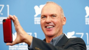 U.S. actor Michael Keaton poses during the photo call for the movie Birdman or (The unexpected virtue of ignorance) at the 71st Venice Film Festival August 27, 2014. REUTERS/Tony Gentile