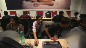 Employees of Snapdeal.com, an Indian online discount shopping website, work inside their company office in New Delhi March 1, 2012.  REUTERS/Parivartan Sharma/Files