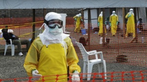 Medicins Sans Frontieres (MSF) health workers prepare at ELWA's isolation camp during the visit of Senior United Nations (U.N.) System Coordinator for Ebola David Nabarro, at the camp in Monrovia August 23, 2014. REUTERS/2Tango