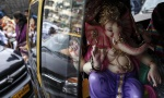 A statue of Ganesh, the deity of prosperity, is carried in a taxi to a place of worship on the first day of the ten-day-long Ganesh Chaturthi festival in Mumbai August 29, 2014. REUTERS/Danish Siddiqui