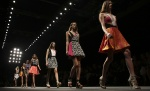Models parade at the end of Byblos Spring/Summer 2015 collection during Milan Fashion Week September 17, 2014.  REUTERS/Stefano Rellandini