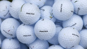 Golf balls are seen on the practice range during a practice round ahead of the British Open golf championship at Royal Lytham and St Annes, northern England July 16, 2012. REUTERS/Eddie Keogh/Files