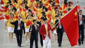 Flag bearer of China Sheng Lei leads the team into the Opening Ceremony of the 17th Asian Games in Incheon September 19, 2014.   REUTERS/Issei Kato