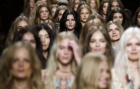 Models present creations from the Etro Spring/Summer 2015 collection during Milan Fashion week September 19, 2014. REUTERS/Alessandro Garofalo
