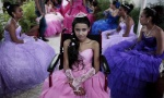 "A cancer patient poses for a photo during her ""Quinceanera"" (15th birthday) party among other celebrants at a hotel in Managua September 20, 2014. REUTERS/Oswaldo Rivas"