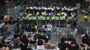 Protesters block a street near government headquarters in Hong Kong September 30, 2014. REUTERS/Carlos Barria