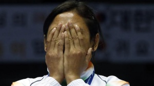 Laishram Sarita Devi reacts during the medal ceremony for the women's light (57-60kg) boxing competition at the Seonhak Gymnasium during the 2014 Asian Games in Incheon October 1, 2014. REUTERS/Kim Kyung-Hoon