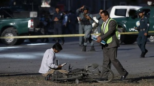 Afghan security personnel investigate at the site of a suicide attack in Kabul October 1, 2014. REUTERS/Omar Sobhani