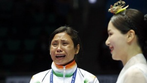India's bronze medallist Laishram Sarita Devi reacts during the medal ceremony for the women's light (57-60kg) boxing competition at the Seonhak Gymnasium during the 2014 Asian Games in Incheon October 1, 2014. REUTERS/Kim Kyung-Hoon/Files