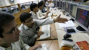 Sensex surges nearly 400 points on energy reform, state elections