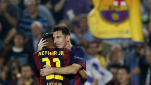 Barcelona's Lionel Messi (R) is congratulated by his teammate Neymar after scoring a goal against Ajax Amsterdam during their Champions League soccer match at Camp Nou stadium in Barcelona October 21, 2014. REUTERS/Albert Gea