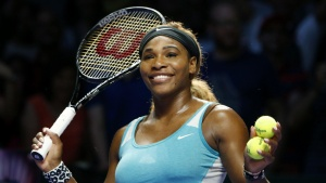 Serena Williams of the U.S. smiles to the crowd after defeating Eugenie Bouchard of Canada during their WTA Finals singles tennis match at the Singapore Indoor Stadium October 23, 2014. REUTERS/Edgar Su