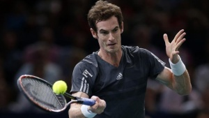 Andy Murray of Britain returns a shot during his men's singles tennis match against Grigor Dimitrov of Bulgaria in the third round of the Paris Masters tennis tournament at the Bercy sports hall in Paris, October 30, 2014. REUTERS/Benoit Tessier