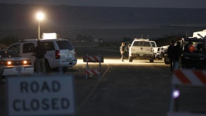 Officials continue to work at the scene of the crash of Virgin Galactic's SpaceShipTwo during nightfall near Cantil, California October 31, 2014. REUTERS/David McNew