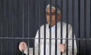 "Satguru Rampalji Maharaj, a self-styled ""godman"" is seen inside a police lock-up after his arrest, at Panchkula in Haryana November 20, 2014. REUTERS/Stringer"