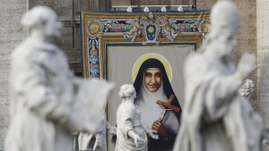 The tapestry with the image of new Indian saint Mother Euphrasia Eluvathingal is seen during a canonisation ceremony led by Pope Francis, to make saints out of six men and women, in Saint Peter's square at the Vatican November 23, 2014. REUTERS/Alessandro Bianchi