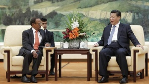 Chinese President Xi Jinping (R) meets with Indian National Security Adviser Ajit Doval (L) at the Great Hall of the People in Beijing September 9, 2014.  REUTERS/Lintao Zhang/Pool