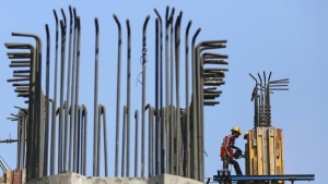 Labourers work at the construction site of a monorail project in Mumbai October 31, 2014. REUTERS/Shailesh Andrade/Files