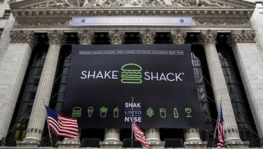 """Signage changing the name to """"New York Shack Exchange"""" is displayed on the facade of the New York Stock Exchange to celebrate the IPO of Shake Shack in New York's financial district January 30, 2015.  REUTERS/Brendan McDermid"""