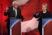 Democratic U.S. presidential candidate Senator Bernie Sanders (L) and former Secretary of State Hillary Clinton discuss an issue during the Democratic presidential candidates debate sponsored by MSNBC at the University of New Hampshire in Durham, New Hampshire, February 4, 2016. REUTERS/Mike Segar