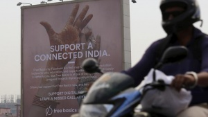 A motorist rides past a billboard displaying Facebook's Free Basics initiative in Mumbai, India, December 30, 2015. REUTERS/Danish Siddiqui/Files