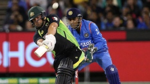 Australia's Aaron Finch (L) hits a six while batting with India's Mahendra Singh Dhoni watching during their T20 cricket match at the Melbourne Cricket Ground, Australia January 29, 2016. REUTERS/Hamish Blair