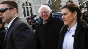 Democratic U.S. presidential candidate Bernie Sanders smiles as he walks along a street near a polling place in Concord, New Hampshire February 9, 2016.   REUTERS/Shannon Stapleton