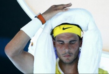 Spain's Rafael Nadal sits in his chair with ice packs on his head during his first round match against Spain's Fernando Verdasco at the Australian Open tennis tournament at Melbourne Park, Australia, January 19, 2016. REUTERS/Thomas Peter
