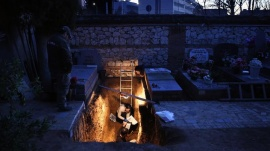 Members of the Association for the Recovery of Historical Memory (ARMH) take part in the exhumation of the grave in Guadalajara's cemetery, Spain, January 24, 2016. REUTERS/Juan Medina