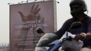 A motorist rides past a billboard displaying Facebook's Free Basics initiative in Mumbai, India, December 30, 2015. REUTERS/Danish Siddiqui