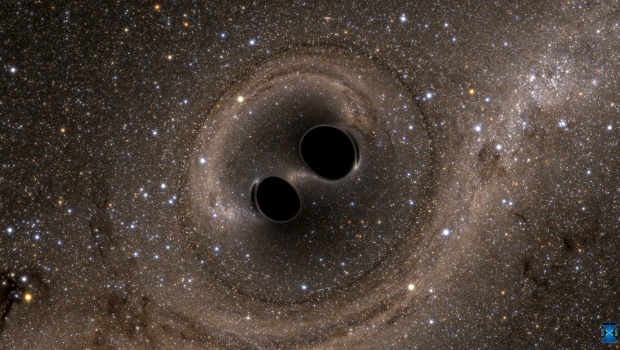 The collision of two black holes holes - a tremendously powerful event detected for the first time ever by the Laser Interferometer Gravitational-Wave Observatory, or LIGO - is seen in this still image from a computer simulation released in Washington February 11, 2016.  REUTERS/Caltech/MIT/LIGO Laboratory/Handout via Reuters