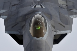 A pilot looks up from a U.S. F-22 Raptor fighter as it prepares to refuel in mid-air with a KC-135 refuelling plane over European airspace during a flight to Britain from Mihail Kogalniceanu air base in Romania April 25, 2016. REUTERS/Toby Melville