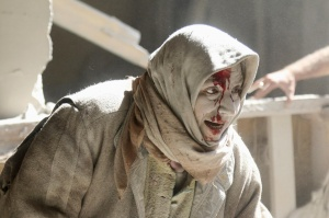 An injured woman reacts at a site hit by airstrikes in the rebel held area of Old Aleppo, Syria, April 28, 2016. REUTERS/Abdalrhman Ismail
