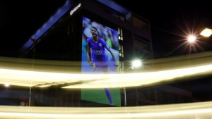 "An image of Leicester City's Riyad Mahrez is projected on to a hotel during the ""Backing the Blues"" campaign in Leicester, Britain April 29, 2016. REUTERS/Darren Staples"