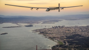 """Solar Impulse 2"", a solar-powered plane piloted by Bertrand Piccard of Switzerland, flies over the Golden Gate bridge in San Francisco, California, U.S. April 23, 2016, before landing on Moffett Airfield following a 62-hour flight from Hawaii.  Jean Revillard/Solar Impulse/Handout via REUTERS"