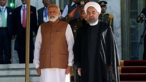 Iran's President Hassan Rouhani (R) stands next to India's Prime Minister Narendra Modi during an official welcoming ceremony in Tehran, Iran May 23, 2016. President.ir/Handout via REUTERS