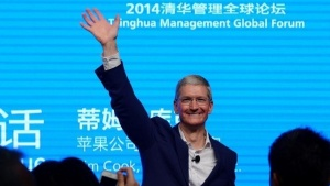 Apple CEO Tim Cook waves as he attends a talk in Beijing October 23, 2014. China Daily/via REUTERS/Files
