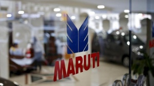 The logo of Maruti Suzuki India Limited is seen on a glass door at a showroom in New Delhi, India, February 29, 2016. REUTERS/Anindito Mukherjee/Files