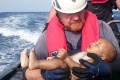 ATTENTION EDITORS - VISUAL COVERAGE OF SCENES OF INJURY OR DEATHA German rescuer from the humanitarian organisation Sea-Watch holds a drowned migrant baby, off the Libyan cost May 27, 2016. The baby, who appears to be no more than a year old, was pulled from the sea after a wooden boat capsized last Friday.    Mandatory Credit   Christian Buettner/Eikon Nord GmbH Germany/Handout via REUTERS    ATTENTION EDITORS - THIS IMAGE WAS PROVIDED BY A THIRD PARTY. FOR EDITORIAL USE ONLY. NO RESALES. NO ARCHIVES. MANDATORY CREDIT. TEMPLATE OUT. THIS PICTURE WAS PROCESSED BY REUTERS TO ENHANCE QUALITY. AN UNPROCESSED VERSION HAS BEEN PROVIDED SEPARATELY.     TPX IMAGES OF THE DAY