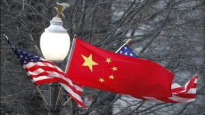 China's national flag is flanked by the U.S. flag along Pennsylvania Avenue near the U.S. Capitol in Washington, January 18, 2011. REUTERS/Hyungwon Kang/Files