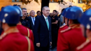 Turkish President Tayyip Erdogan reviews a guard of honour as he arrives to the Turkish Parliament in Ankara, Turkey, July 22, 2016. REUTERS/Umit Bektas