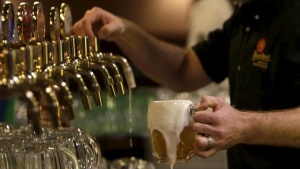 A bartender drafts a glass of beer at Plzensky Prazdroj (Pilsner Urquell) brewery in Plzen, Czech Republic, November 12, 2015. REUTERS/David W Cerny