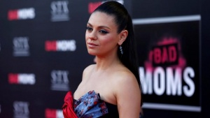 """Cast member Mila Kunis poses at the premiere of """"Bad Moms"""" in Los Angeles, California U.S., July 26, 2016.   REUTERS/Mario Anzuoni"""