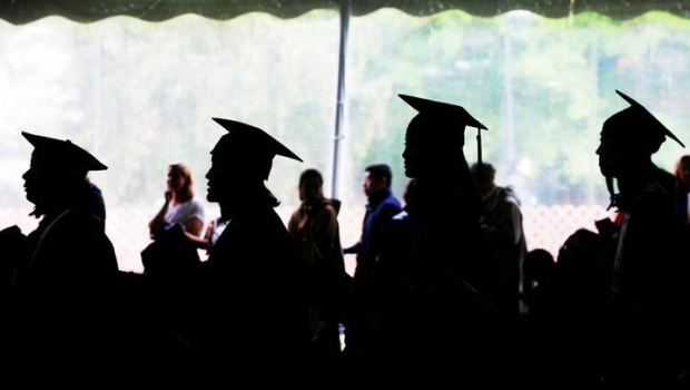 Graduating seniors line up to receive their diplomas during Commencement at Wellesley College in Wellesley, Massachusetts, U.S., May 26, 2017. REUTERS/Brian Snyder