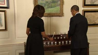 Obamas mark Newtown anniversary with moment of silence