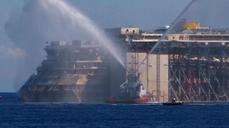 Celebrations as Costa Concordia begins final journey