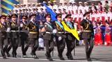 Ukraine defiant on national day, rebels parade captured soldiers