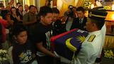 Funeral takes place in Malaysia for a pilot of downed MH17 flight