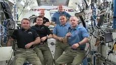 Soyuz capsule heads back to earth carrying trio of from U.S. and Russia